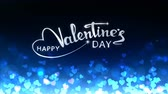 hand written : Glowing hearts appear on the shining blue background with glow animated text. Valentines Day holiday abstract loop animation.