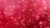 decorative symbol : Red hearts appear on the shining soft background. Valentines Day holiday abstract loop animation.
