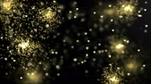 Holiday bright shining background with holiday gold sparcles in space. Looped 4K motion graphic. Vídeos