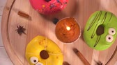 кинозвезды : Colorful iced donuts for a birthday celebration