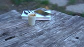 ハードカバー : Book, glasses, coffee and mobile on an old table