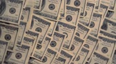 pay off : Multiple US 100 dollar bills covering a table Stock Footage
