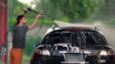 hosepipe : Low angle panning up to roof of a car being washed