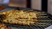 grelhado : Rotating grill packed with assorted kebabs