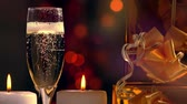 Pouring a glass of champagne with party lights Stock Footage