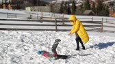śnieżka : Active Family is Enjoying Sunny Warm Weather During Vacation in the Countryside. Restless Mother is Playing in Snowball Fight with Her Daughter and Son in Winter Outdoors.
