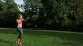 fitness : Pretty young jogger running in the park
