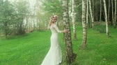 romantizm : Attractive bride walking among trees Stok Video