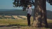 cloud : Young businessman resting in the countryside
