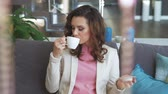 Beautiful woman relaxing and drinking coffee