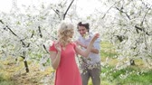 prato : Cheerful couple enjoying a relaxing time in the orchard Stock Footage