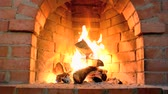 karácsony : A hot fire burns in a stone fireplace. Stock mozgókép