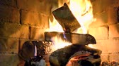 brick : A hot fire burns in a stone fireplace. Stock Footage