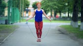 Attractive Young Fitness Women Exercising Jumping Rope