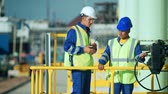 rafineri : Industrial engineer and worker discussing in factory