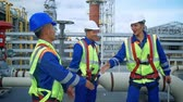 Architect and construction workers shaking hands