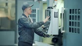 operador : Industrial engineer worker operating control panel system at manufacture plant Stock Footage