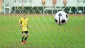 trest : A young boy scores a goal during a penalty shoot out. Shot in slow motion