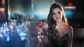 elite : Beauty young brunette woman sitting at the bar with glass of wine in luxury interior Stock Footage