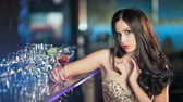 celebridade : Beauty young brunette woman sitting at the bar with glass of wine in luxury interior Vídeos