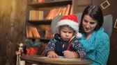 lista : Mother and little son writing letter to Santa Claus