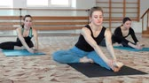 viraj : Group of young women making yoga stretching in the fitness class