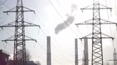 smoke : Industrial landscape. power line and smoke from pipes of combined heat and power plant Stock Footage