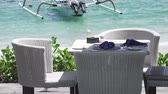 The tropical sea resort, the beach and boats in the ocean in sunny day