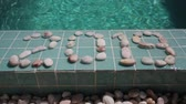 Celebration of new year,Date 2019 is laid out by pebble stones on the edge of the pool in the tropical resort
