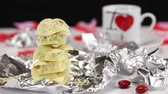 guloseima : Demonstration of pieces of white chocolate in the shape of a pyramid from blur to focus Stock Footage