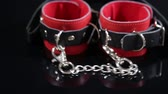sex : mask and red leather handcuffs for BDSM games. sex toys. Stock Footage