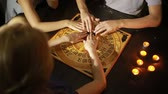 psychic : group of people at a spiritualistic. people call spirits
