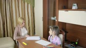conversation : Child psychologist with a little girl. childrens psychological counseling