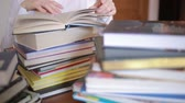 campus : Education school concept. Closeup female girl in college library with books Stock Footage
