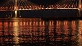 bridge across the river : At night, the lights of the city flicker on the water. Cable-stayed bridge across the river