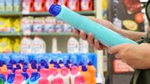 condicionador : woman chooses shopping in the store household chemicals and cosmetics. 4k, slow-motion