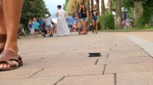 mentira : somebody loses his wallet that falls on the pavement in the city. 4k, slow-motion