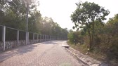 trafik : Pavement, movement on the road paved with tiles in the countryside. 4k, slow-motion , copy space Stok Video