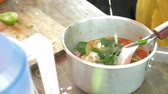 kaffir lime leaves : Cooking Thai soup Tom Yam, 4k, Slow motion