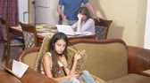 sofa : the girl is present in the parental quarrel. father and mother swear. the daughter ignores the conflict between the parents. 4k