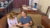 hysterics : the boy is present at the parents quarrel. father and mother swear. 4k Stock Footage