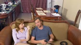 annoyed : the boy is present at the parents quarrel. father and mother swear. 4k Stock Footage