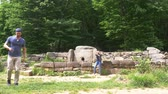 taşlar : Dolmen in the forest. 4k, slow motion. tourists explore the ancient dolmens Stok Video