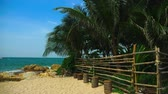 astarlı : Bamboo pole fence on a tropical island. white sandy beach with palm-lined shore.