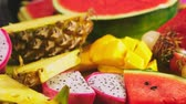 melão : Mixed tropical fruits, closeup. fresh fruit sliced. background.