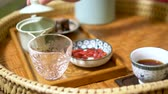 tea bowl : Traditional chinese tea ceremony. Goji berry tea and dessert. Stock Footage