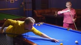 друзья : couple, man and bald woman play american billiards.