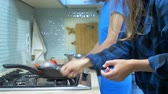 homosexuel : two girls, lesbian family preparing food in the kitchen at home
