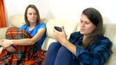 lésbica : family lesbian couple talking together while sitting on sofa at home