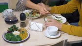 obiad : couple man and woman eating in vegetarian restaurants healthy food Wideo